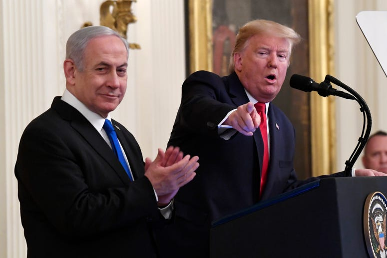 President Donald Trump speaks during an event with Israeli Prime Minister Benjamin Netanyahu in the East Room of the White House in Washington, Jan. 28, 2020.