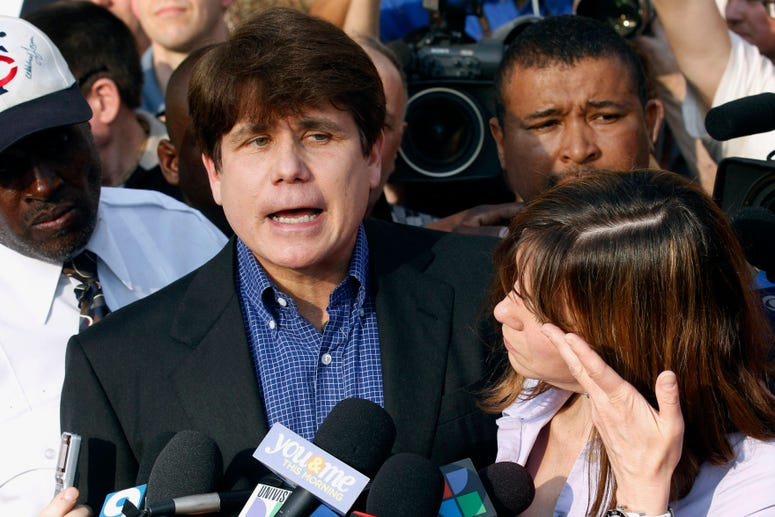 Former Illinois Gov. Rod Blagojevich speaks to the media outside his home in Chicago on March 14, 2012, as his wife, Patti, wipes away tears a day before reporting to prison after his conviction on corruption charges.