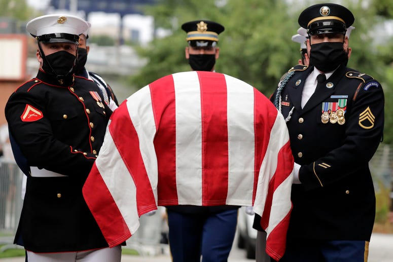 A military honor guard moves the casket of Rep. John Lewis into Ebenezer Baptist Church for his funeral, Thursday, July 30, 2020, in Atlanta.