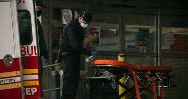 Paramedics disinfect a strecher.