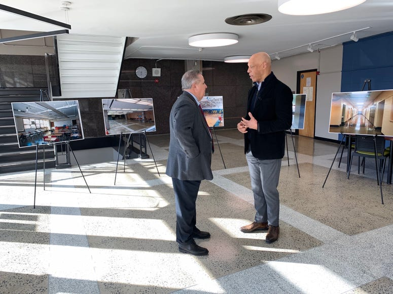 Interim district facilities chief Jim Creedon, left, talks with Superintendent Hite before a media tour of the building