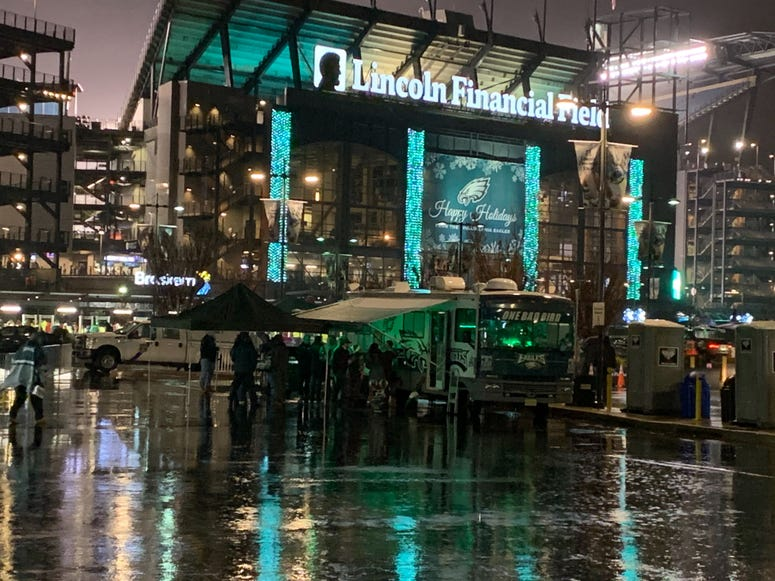 Rain soaks the Eagles tailgate before their game against the Giants.