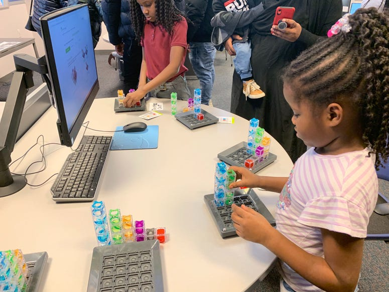 Students give demonstrations during a ribbon-cutting at the new STEAM Lab in North Philadelphia.