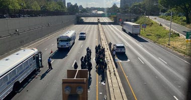Police officers arresting protesters on the Vine Street Expressway