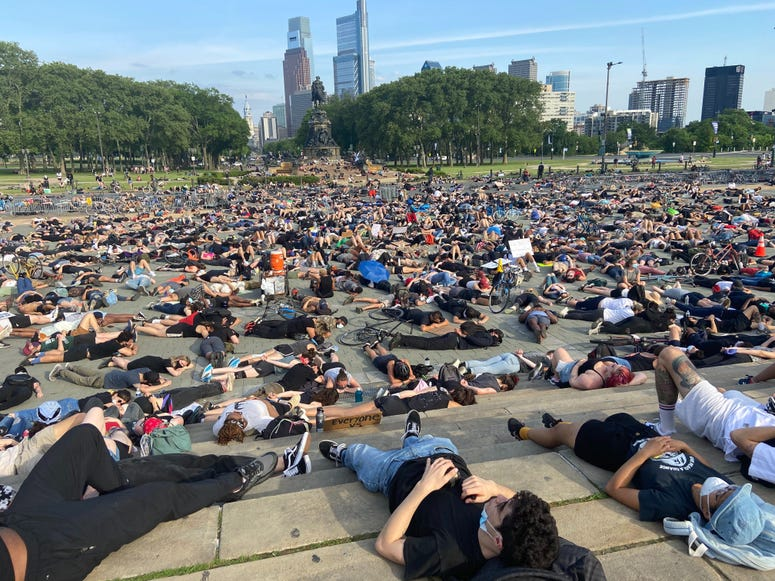 Protesters lying down at the Art Museum steps in honor of George Floyd
