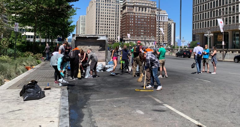 People helping to clean up in the City Hall area Sunday morning.