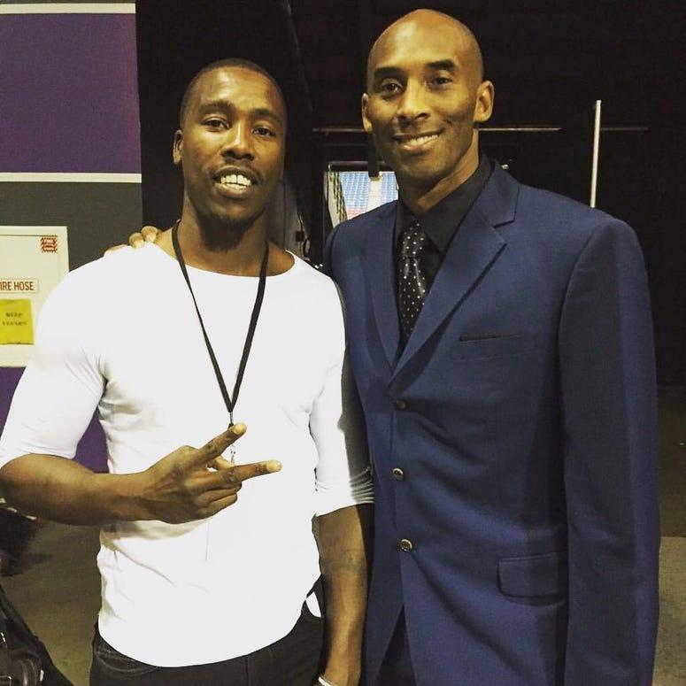 Tasheed Carr (left) with Kobe Bryant