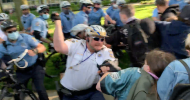Officer hits protester with baton