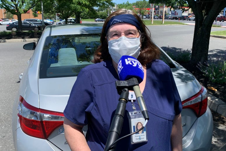Sharon says wearing a mask is required for her as a home health-care aide, but clients aren't required to wear them.