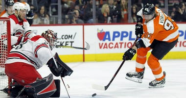 Philadelphia Flyers' Jakub Voracek, right, attacks as Carolina Hurricanes goalie Scott Darling defends during the second period of an NHL hockey game Thursday, April 5, 2018, in Philadelphia