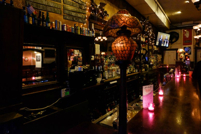 The hand-carved bar at the Khyber Pass Pub today is the same one from Prohibition days.