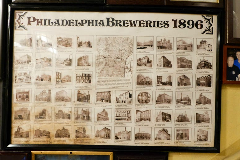 A framed poster at McGillin's Old Ale House shows the vast array of breweries in the 19th Century in Philadelphia.