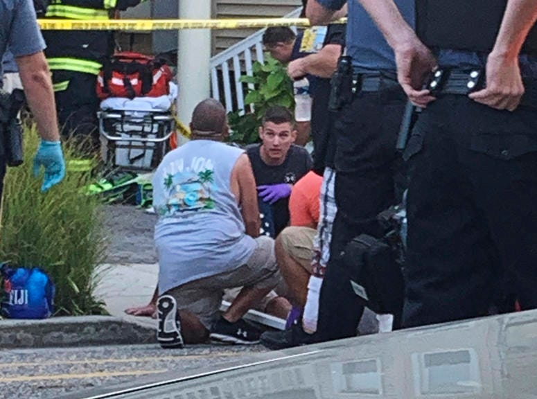 First responders treat an injured person as they work the scene of a building structure damage in Wildwood, N.J.