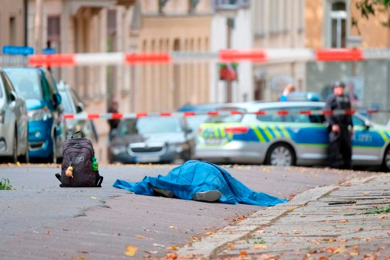 A body lies on a road in Halle, Germany.