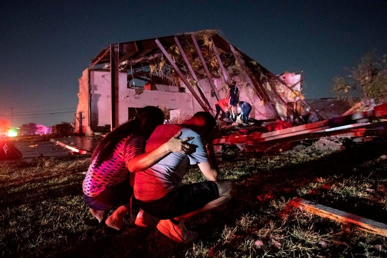 Henry Ramirez, a member of Primera Iglesia Dallas, is consoled by his mother Maribel Morales as they survey severe damage to the church, where Ramirez plays drums and Morales attends, after a tornado tore through North Dallas.