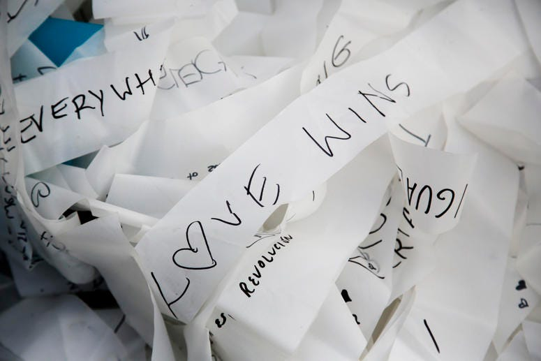 Streamers with written messages as part of the skynet artwork 'Visions In Motion' lay on the ground prior to the setup of the artwork at the 'Strasse des 17. Juni' (Street of June 17) boulevard in front of the Brandenburg Gate in Berlin, Germany.