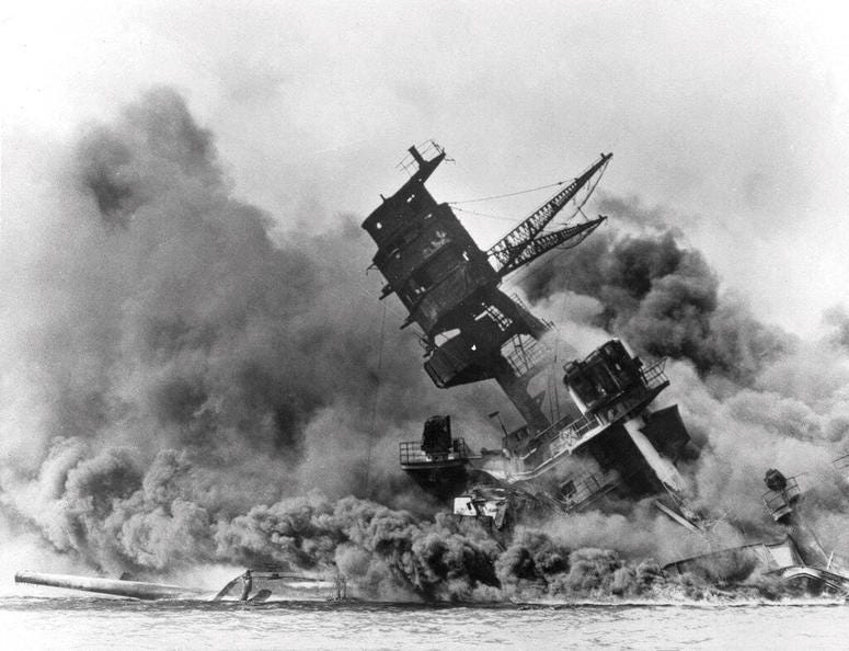 In this Dec. 7, 1941 file photo, smoke rises from the battleship USS Arizona as it sinks during the Japanese attack on Pearl Harbor, Hawaii.