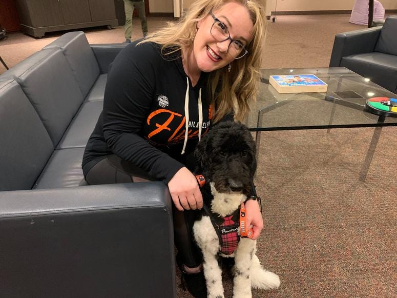 Neuropsychologist Jennifer West-Gavin with service companion dog Lullaby.