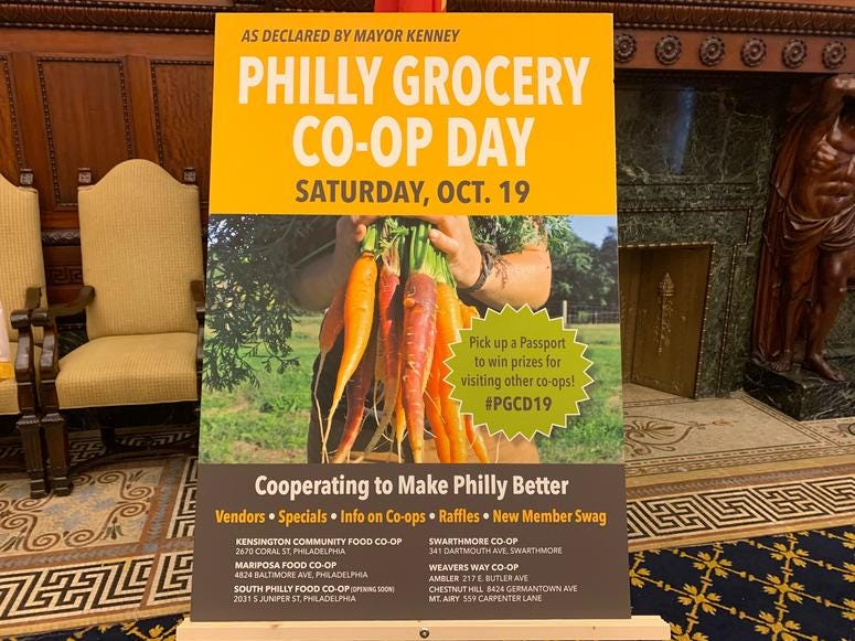 A sign announces Philly Grocery Co-op Day