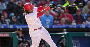 Apr 5, 2018; Philadelphia, PA, USA; Philadelphia Phillies third baseman Maikel Franco (7) hits a two RBI single during the first inning against the Miami Marlins at Citizens Bank Park.