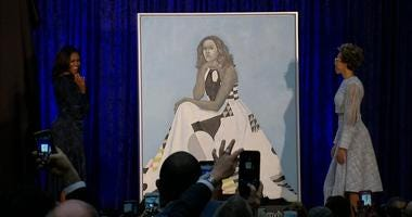 The distinctive Amy Sherald painting of the former first lady, unveiled at the Smithsonian's National Portrait Gallery last month