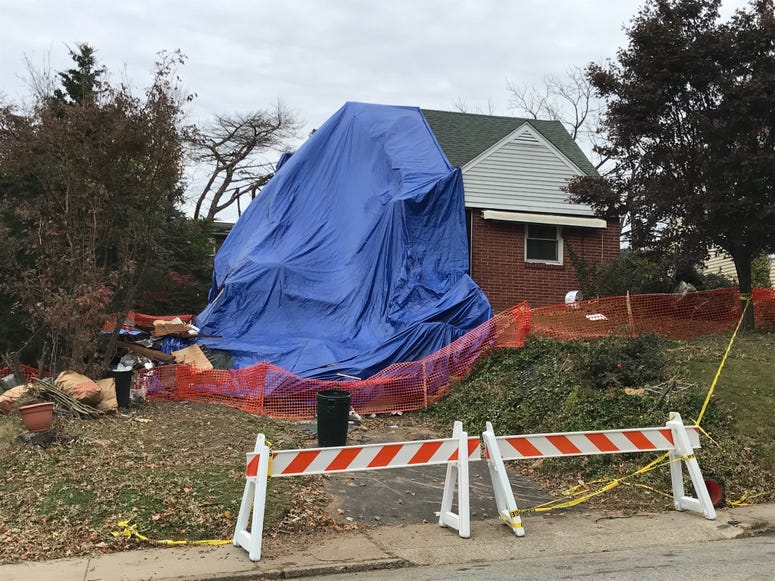 Percy Cupid and his wife, Frances, were trapped when a tree hit their house and their bedroom collapsed onto the first floor.