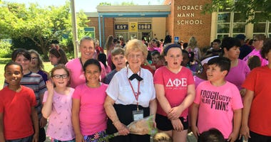 Claire Bauman, students and staff mark a milestone for the school crossing guard at Horace Mann Elementary School in Cherry Hill.