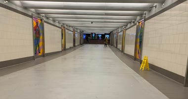 Philadelphia police say a man stabbed a woman in a SEPTA concourse at 15th Street and JFK Boulevard in Center City on Tuesday night.