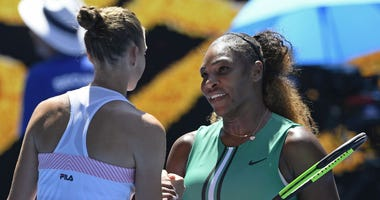 Karolina Pliskova of the Czech Republic, left, is congratulated by United States' Serena Williams after winning their quarterfinal match at the Australian Open tennis championships in Melbourne, Australia, Wednesday, Jan. 23, 2019.