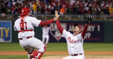 Philadelphia Phillies closer Brad Lidge and catcher Carlos Ruiz celebrate a World Series championship