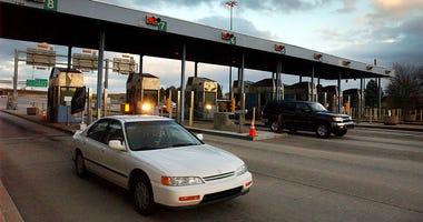 Motorists pass through Downingtown Interchange of the Pennsylvania Turnpike in Uwchlan Township in Pennsylvania.
