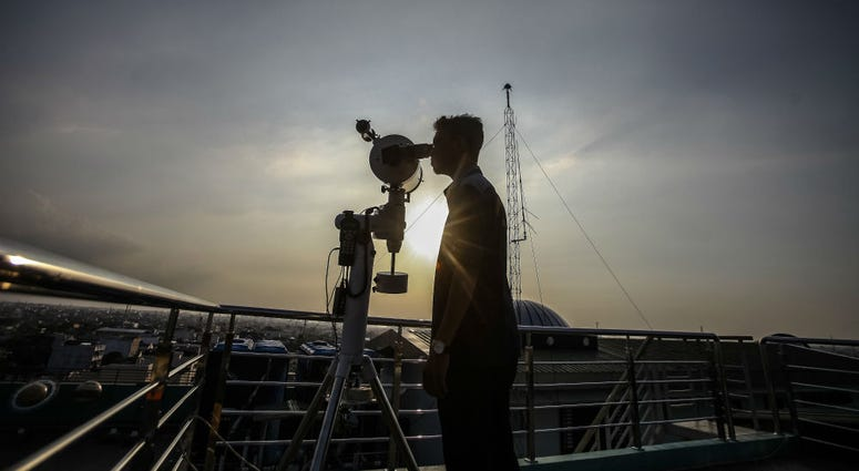 A man looks through a telescope to determine the sighting of the new moon to mark the start of the fasting month of Ramadan.