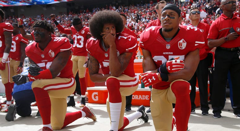 From left: The San Francisco 49ers' Eli Harold (58), Colin Kaepernick (7) and Eric Reid (35) kneel during the national anthem before their a game against the Dallas Cowboys on Oct. 2, 2016.