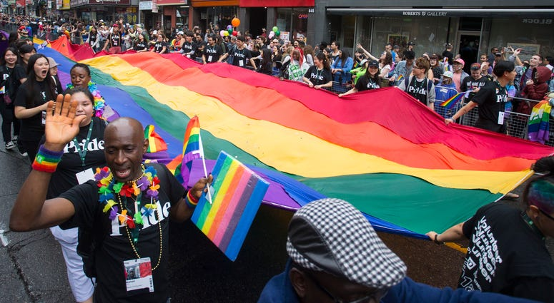 People take part in the 2018 Toronto Pride Parade