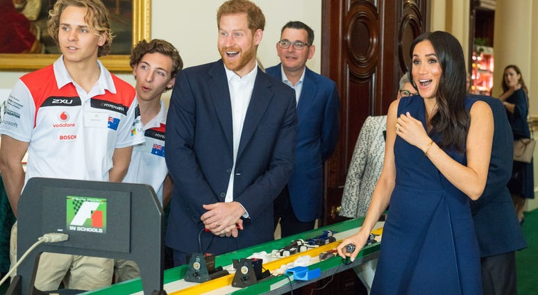 0/18/2018 - The Duke and Duchess of Sussex react after starting model Formula 1 cars at a demonstration by Formula 1 in Schools, at a reception given by the Governor of Victoria, at Government House.