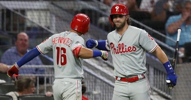 The Philadelphia Phillies' Cesar Hernandez, left, and Bryce Harper