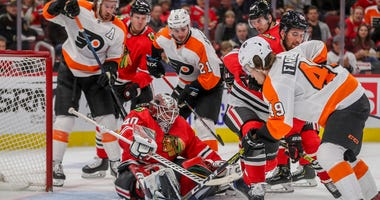 Chicago Blackhawks goaltender Robin Lehner (40) guards the net while the Philadelphia Flyers' Joel Farabee (49) looks to score amid second-period traffic at the United Center in Chicago on Thursday, Oct. 24, 2019.