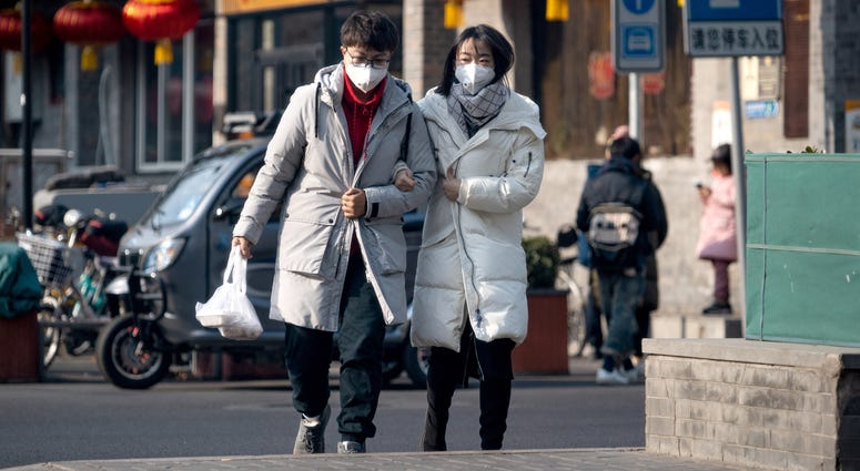 Citizens wear face masks; a number of pneumonia-like coronavrius cases has reportedly exceeded 400 due to its mutation and airborne nature.