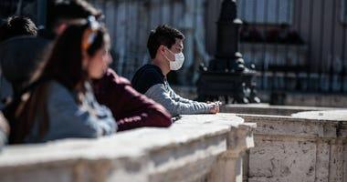 Tourists at Trinita de' Monti, Spagna Square, in Rome, wear protective masks against the coronavirus epidemic.