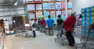 Customers line up for toilet paper at a Costco warehouse store in Toronto, Canada, March 11, 2020.