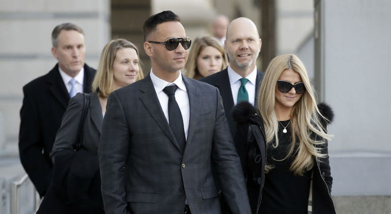 "Michael ""The Situation"" Sorrentino walks with his fiancee Lauren Pesce while leaving the federal courthouse after a hearing in Newark, N.J., on Jan. 19, 2018."