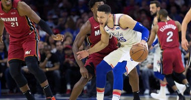 Ben Simmons (25) dribbles against the defense of Miami Heat forward Justise Winslow (20) during game two of the first round of the 2018 NBA Playoffs.