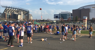 Sixers fans tailgate outside the Wells Fargo Center.