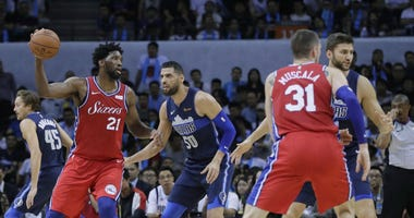 Joel Embiid of the Philadelphia 76ers (21) controls the ball away from Salah Mejri of Dallas Mavericks during the Shenzhen basketball match, part of the NBA China Games, in Shenzhen city, Monday, Oct. 8, 2018.