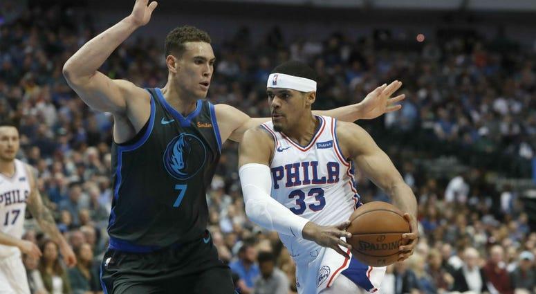 Philadelphia 76ers forward Tobias Harris (33) drives against Dallas Mavericks forward Dwight Powell (7) during the first half of an NBA basketball game in Dallas, Monday, April 1, 2019.