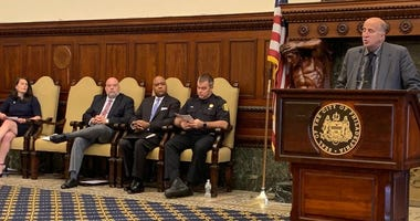 City Councilmember Mark Squilla is joined by Philadelphia fire officials in announcing the results of an investigation into an explosion at 8th and Reed streets on Dec. 19, 2019.