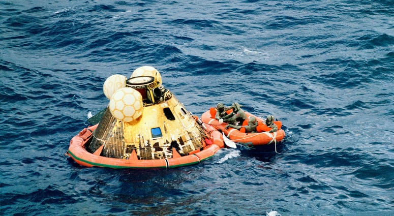 Columbia's hatch is closed with the three crew in the life raft along with Lt. Clancy Hatleberg..