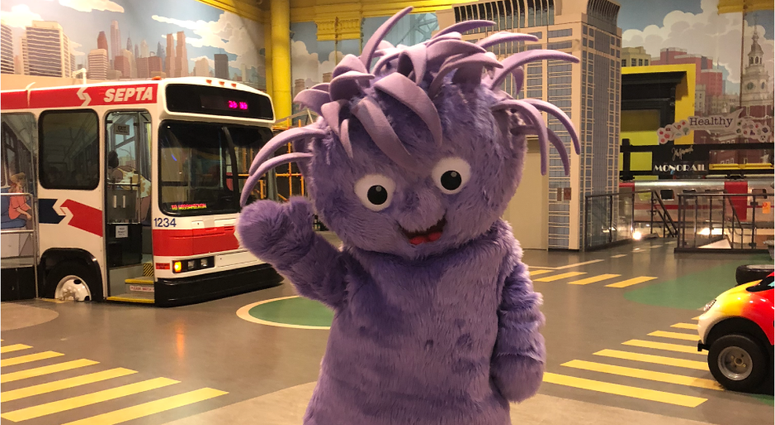 The Please Touch Museum has introduced its new mascot, a purple, fuzzy, wide-eyed creature named Squiggles.