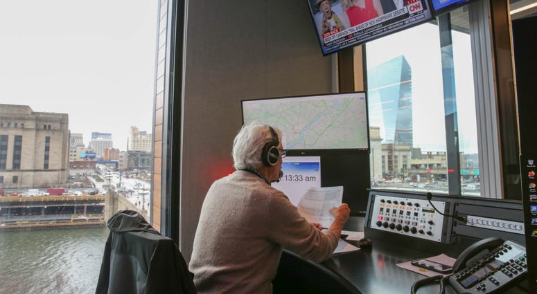 Sam Clover has an unobstructed view of I-76 in the brand new KYW Traffic Center.
