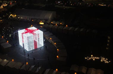 A 27-foot-tall Christmas present sits in the middle of the Christmas Village in LOVE Park.